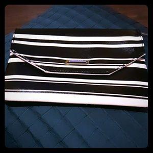 Anne Klein black and white striped wristlet.  New!